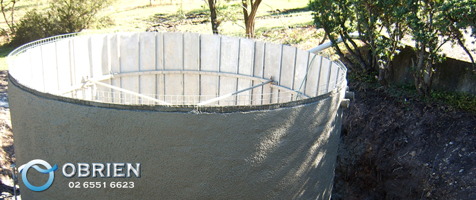 Above ground concrete water tank under construction in bushland (Port Macquarie/Hastings Region)